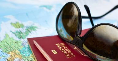 Picture of passport and sunglasses