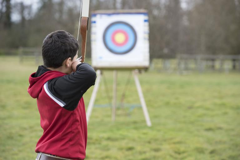 Student taking part in the archery elective
