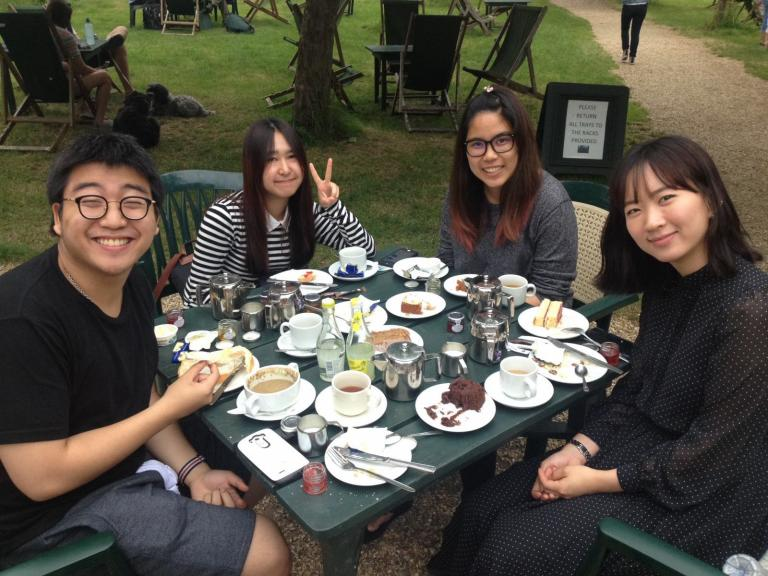 Students sampling some delicious scones at the Orchard Tea Gardens in Grantchester