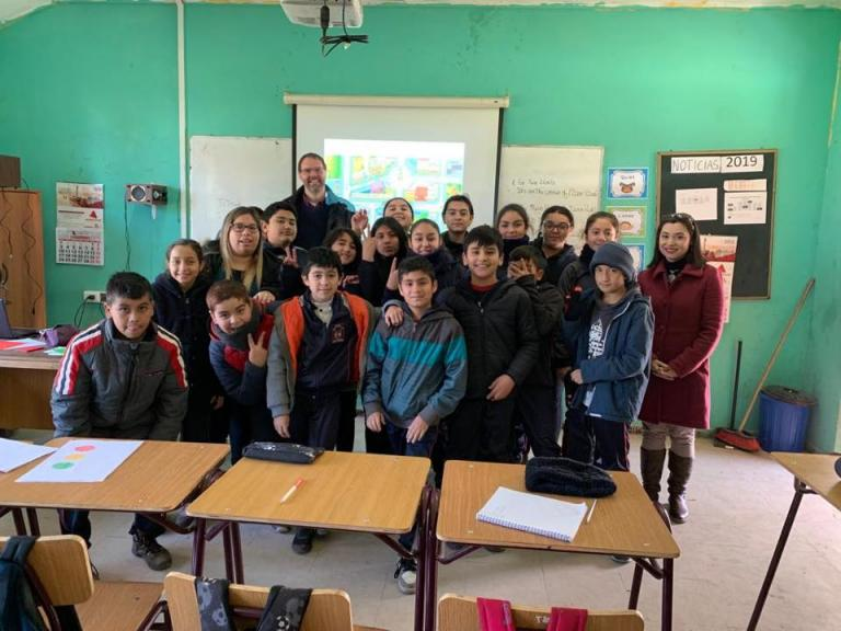 Bell's Chris Edgoose with teacher and students in Chile after observation