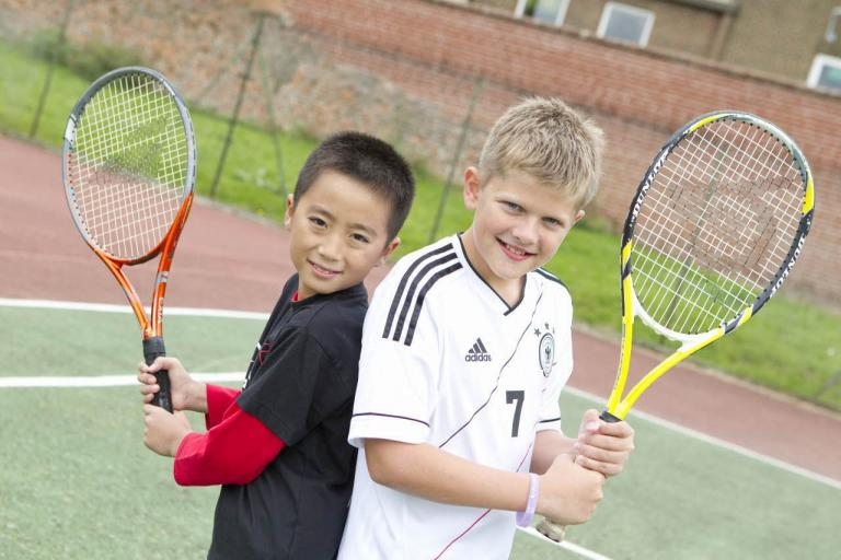 Bell juniors playing tennis