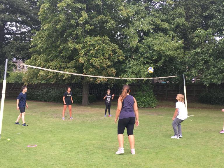 Students at The Leys playing volleyball