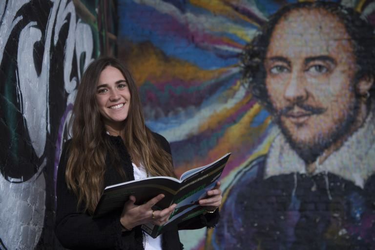 Student reading by Shakespeare painting in London