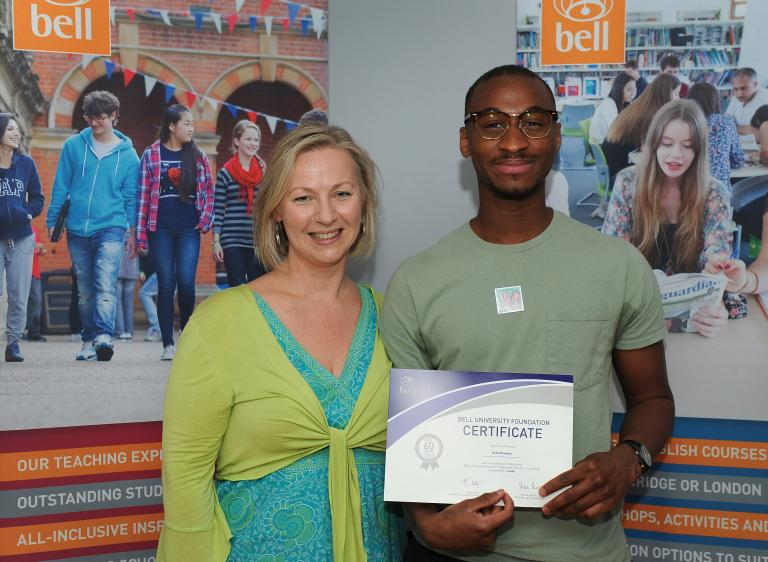Kebe receiving his certificate