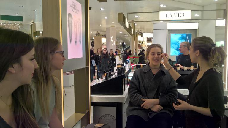 Enjoying a beauty workshop at John Lewis, a British department store