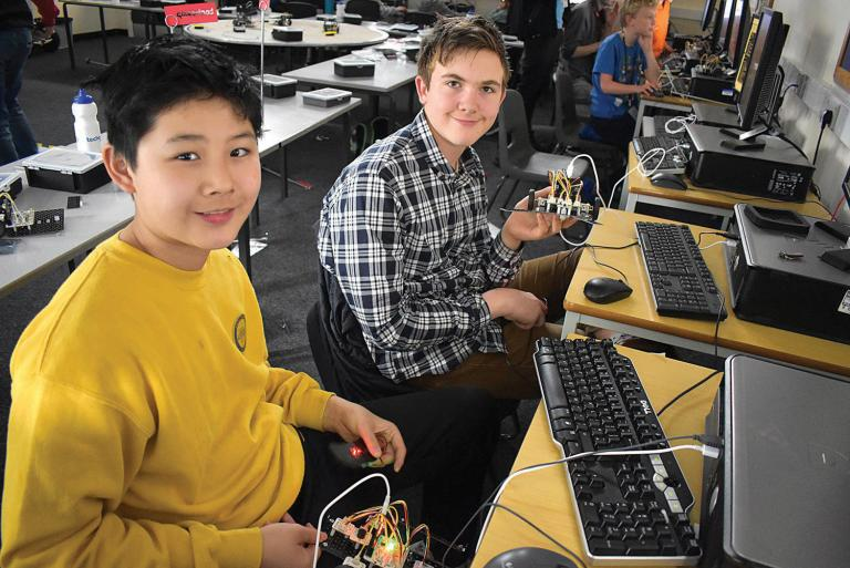 Two students with their robots
