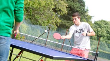 Students playing table tennis at Bell Cambridge