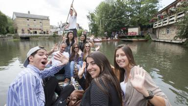 Bell Cambridge students punting on the River Cam