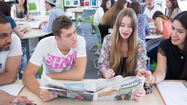 Students reading newspapers
