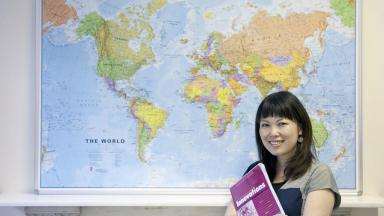 Trainee teacher in front of map
