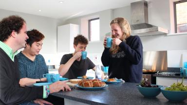 Students eating in their kitchen in Tripos Court
